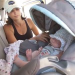 В машине с новорожденным.